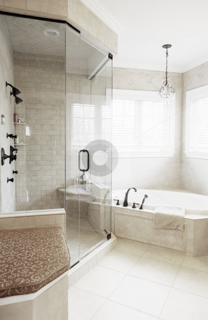 Upscale Bathroom Interior stock photo, Upscale neutral-toned bathroom with jacuzzi tub and shower. Vertical format. by Christopher Nuzzaco
