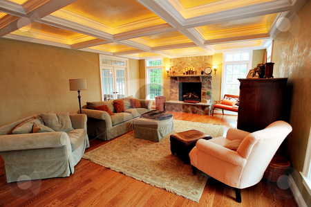 Upscale Living Room Interior stock photo, View of an upscale living room interior with a box beam ceiling. Horizontal format. by Christopher Nuzzaco