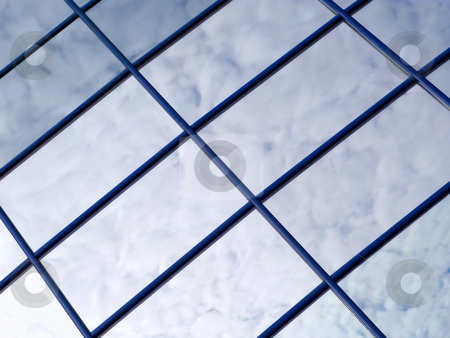 Abstract cloud reflections on windows in a tower block. stock photo, Abstract cloud reflections on windows in a tower block. by Stephen Rees
