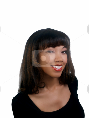Smiling portrait of black woman with braces upper teeth stock photo, Portrait of pretty African American woman with braces by Jeff Cleveland