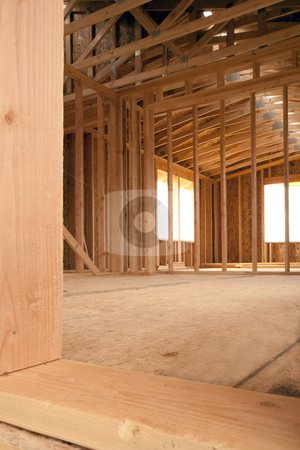 Construction Site Interior stock photo, Interior of a construction site of a partially built building with framing beams erected. Vertical shot. by David Papazian