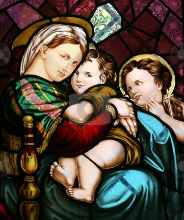 Virgin Mary holding baby Jesus stock photo, Stained glass depicting the Virgin Mary holding baby Jesus by Zvonimir Atletic