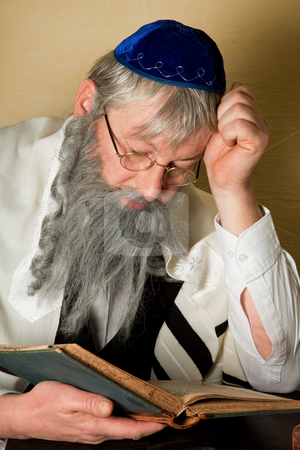 Reading a jewish book stock photo, Old jewish man with beard reading a book by Anneke
