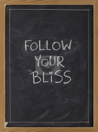 Follow your bliss - reminder stock photo, Follow your bliss spiritual reminder - white chalk handwriting on a blackboard by Marek Uliasz