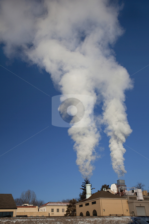 Smoke and steam plume stock photo, Two smoke and steam plumes from a small heating plant on cold winter mornings at Colorado State University campus, Fort Collins by Marek Uliasz