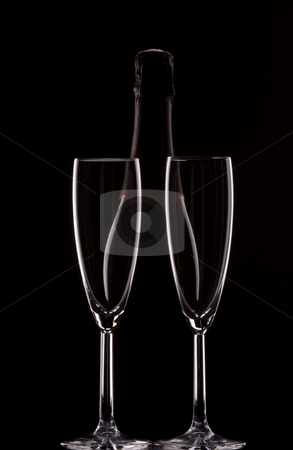 Backlit champagne bottle stock photo, Silhouette of a champagne bottle with two glasses by Jandrie Lombard