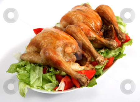 Two roast chickens on a bed of salad stock photo, Two roast chickens on a bed of salad by Paul Cowan