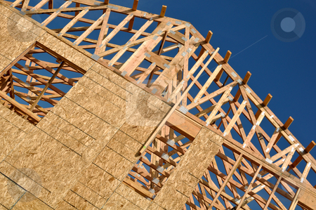 New Home Under Construction stock photo, New Home Under Construction with blue sky by Brandon Bourdages