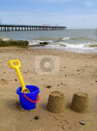 Kids bucket, spade and sandcastles on Felixstowe beach. stock photo, Kids bucket, spade and sandcastles on Felixstowe beach. by Stephen Rees