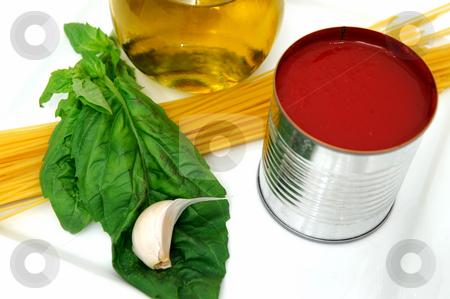 Marinara sauce  stock photo, Marinara sauce ingredients including Olive oil, Basil leaves, fresh garlic, tomato sauce and pasta by Lynn Bendickson