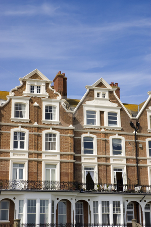 Townhouses stock photo, A row of victorian townhouses with a blue sky by Mark Bond