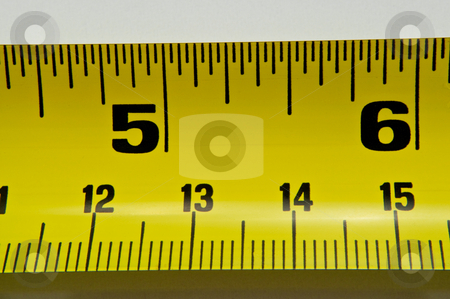 Tape measure stock photo, Close up of a section of metal tape measure against white background. by Samantha Craddock