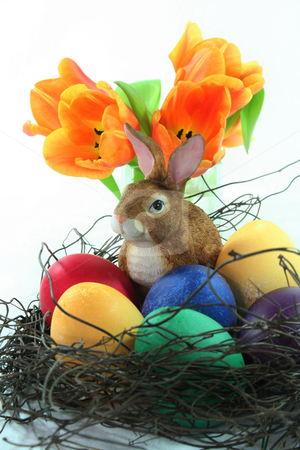 Easter basket with eggs and Easter bunny and tulip stock photo, Easter basket with Easter eggs and Easter bunny and tulips on a white background by Marén Wischnewski