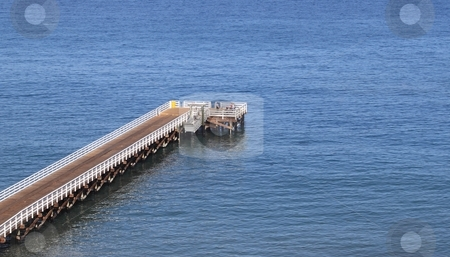 Pier stock photo, Pier at santa cruz island with blue ocean water by Henrik Lehnerer