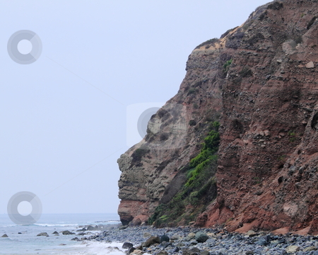 Rock Face stock photo, Rock cliff shaped like a face at Dana Point by Henrik Lehnerer