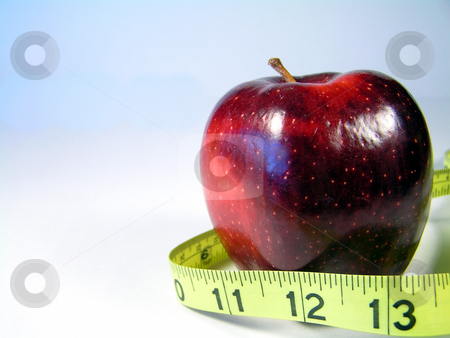 Apple with tape measure stock photo, Apple on white with measuring tape signifying weight watching or weight loss by Christy Thompson