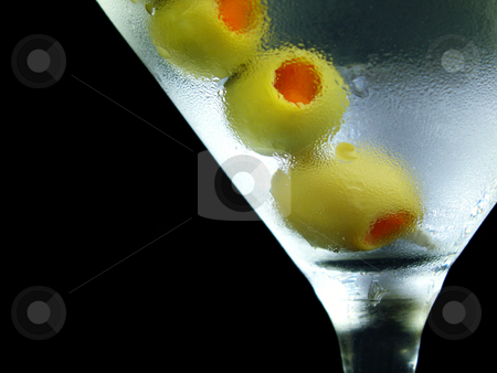 Martini middle stock photo, Martini with olives isolated on black by Christy Thompson