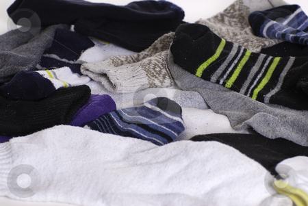Unmatched Socks stock photo, Background of unmatched and mixed colored socks by Richard Nelson