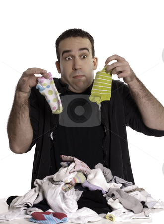 Matching Socks stock photo, A young man doesn't know how to match socks, isolated against a white background by Richard Nelson