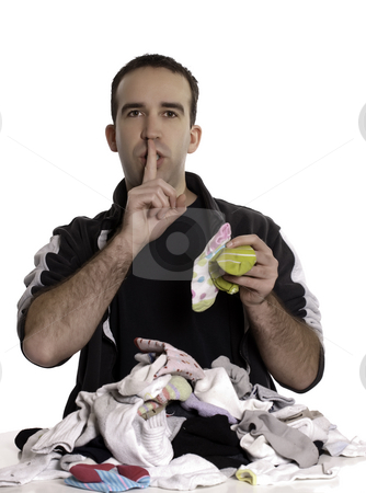 Man Matching Mixed Socks stock photo, A young man matching socks that don't go together and saying shhh. by Richard Nelson