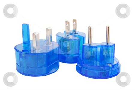 Blue transparent international plugs isolated on white backgroun stock photo, Blue transparent international plugs isolated on white background by Igor Sandra