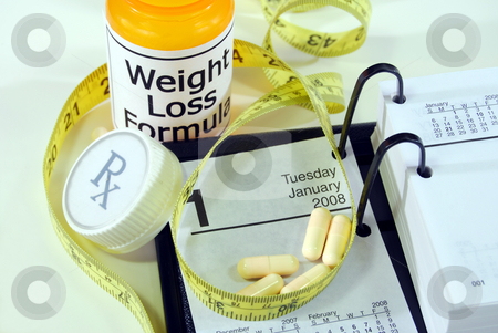 New Year's Resolution: Medical Weight Loss 2 stock photo, Prescription bottle with tailor's measuring tape near calendar open to January 1st. by Christy Thompson