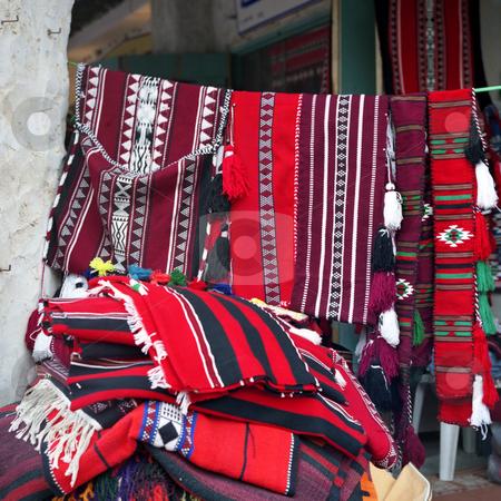 Arab textiles on sale stock photo, Traditional Arab textile designs on sale in Souq Waqif, Qatar, Arabia. 6x6 film image. by Paul Cowan