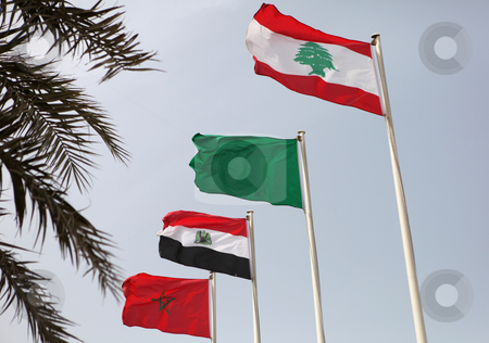 Arab league flags stock photo, The flags of (from the front) Lebanon, Libya, Egypt and Morocco flying during the Arab League summit in Doha, Qatar, March 2009 by Paul Cowan