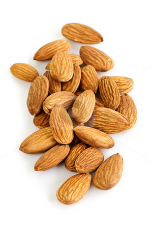 Almonds stock photo, Raw almonds in a pile isolated on white background by Elena Elisseeva