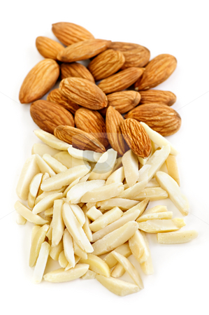Slivered and whole almonds stock photo, Whole and slivered raw almonds in a pile on white background by Elena Elisseeva