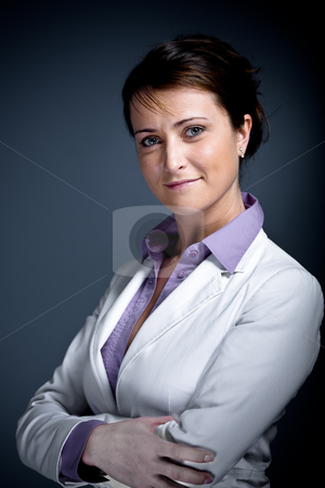 Office stock photo, A young woman in the office by Val Thoermer