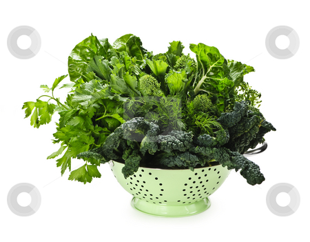 Dark green leafy vegetables in colander stock photo, Dark green leafy fresh vegetables in metal colander isolated on white by Elena Elisseeva