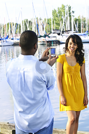 Woman posing for picture near boats stock photo, Beautiful woman posing for vacation photo at harbor with sailboats by Elena Elisseeva