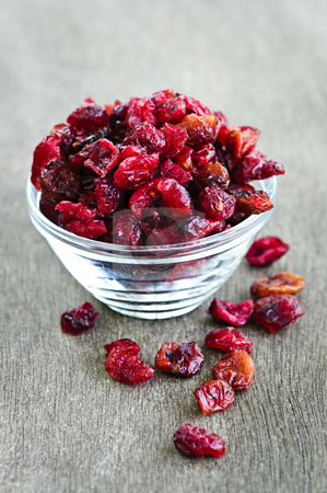 Bowl of dried cranberries stock photo, Dried cranberries spilling out of glass bowl by Elena Elisseeva