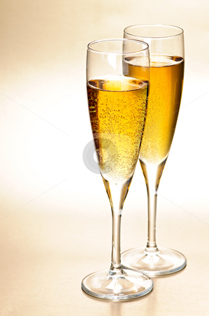 Champagne glasses stock photo, Two full champagne flutes with sparkling wine by Elena Elisseeva