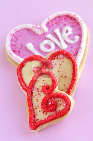 Valentines cookies stock photo, Homemade baked shortbread Valentine cookies with icing on pink background by Elena Elisseeva