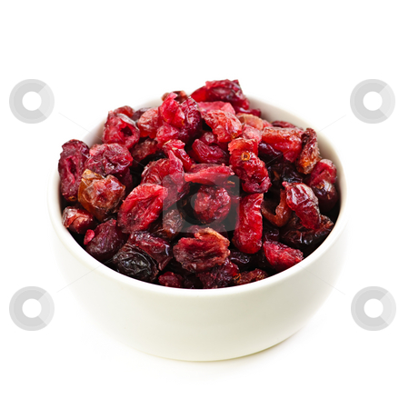 Bowl of dried cranberries stock photo, Bowl of dried cranberries isolated on white background by Elena Elisseeva