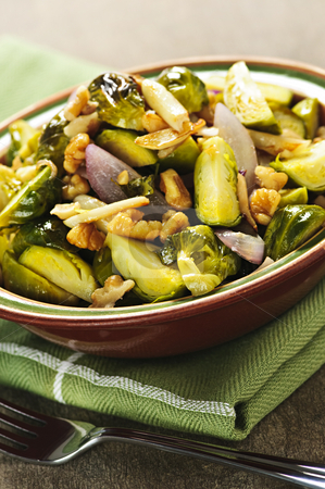 Roasted brussels sprouts dish stock photo, Vegetarian bowl of roasted brussels sprouts with walnuts by Elena Elisseeva