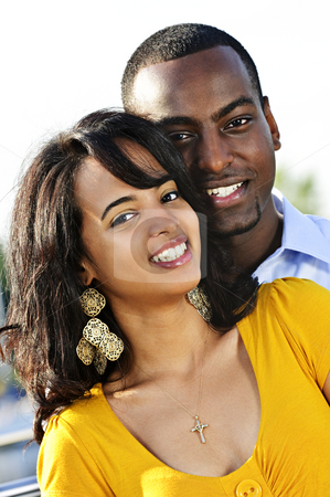 Portrait of happy couple stock photo, Portrait of young romantic couple standing at harbor by Elena Elisseeva