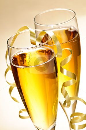 Champagne glasses stock photo, Two full champagne flutes with sparkling wine and ribbon by Elena Elisseeva