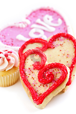Valentines cookies stock photo, Homemade baked shortbread Valentine cookies and cupcake with icing on white background by Elena Elisseeva