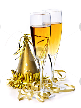 Champagne and New Years decorations stock photo, Two full champagne flutes with party hat and ribbon isolated on white background by Elena Elisseeva