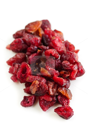 Dried cranberries stock photo, Pile of dried cranberries isolated on white background by Elena Elisseeva