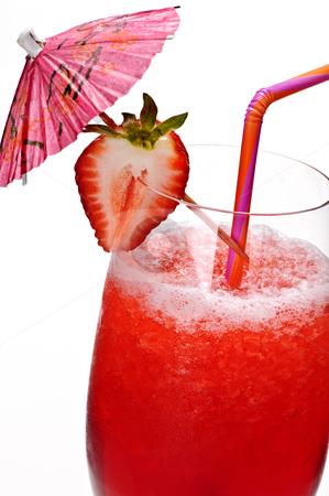 Strawberry daiquiri stock photo, Strawberry daiquiri in glass isolated on white background with umbrella by Elena Elisseeva