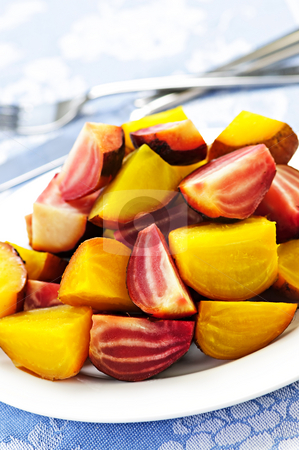 Roasted red and golden beets stock photo, Roasted sliced red and golden beets on a plate by Elena Elisseeva