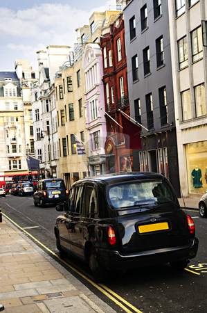 London taxi on shopping street stock photo, London street with taxicab and shops on sunny day by Elena Elisseeva