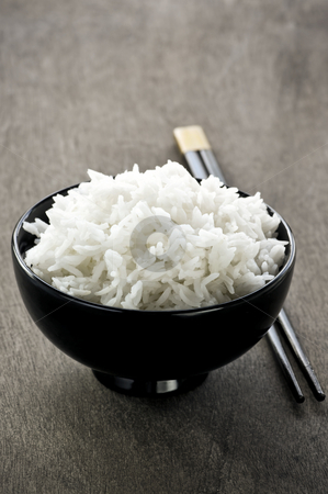 Rice bowl and chopsticks stock photo, White steamed rice in asian bowl with wooden chopsticks by Elena Elisseeva