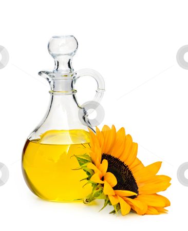 Sunflower oil bottle stock photo, Sunflower oil bottle and flower isolated on white by Elena Elisseeva
