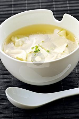 Wonton soup stock photo, Wonton soup in white bowl with spoon by Elena Elisseeva