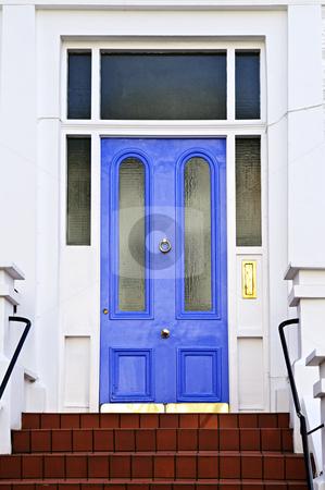 Blue door in London stock photo, Blue front door with brass knocker in London England by Elena Elisseeva